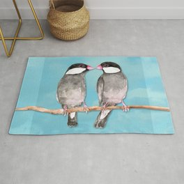 Two kissing Java sparrows Rug