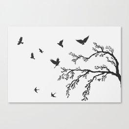 flock of flying birds on tree branch Canvas Print
