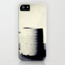 Cup of coffee on a table iPhone Case