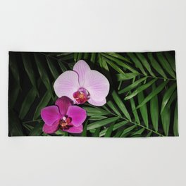 Orchids with palm leaves Beach Towel