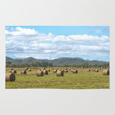 Hay bales on a sunny day Rug