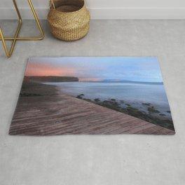 Beach at sunset Rug