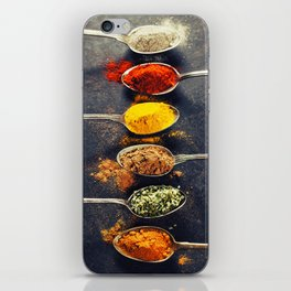 Colorful spices in metal spoons iPhone Skin