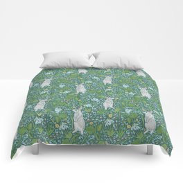 Grey hares with coltsfoots and snowdrops on green background Comforters
