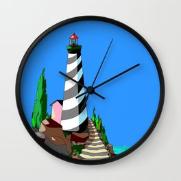 A Lighthouse over looks the Rocky Cove and Beach Wall Clock