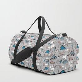 Origami dino friends // grey linen texture blue dinosaurs Duffle Bag