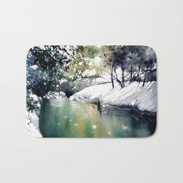 Running water down below in the dark, frozen forest Bath Mat