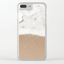 Wave gently washes up on a sandy beach Clear iPhone Case