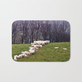 Cattle Eating Hay on a Hill Bath Mat