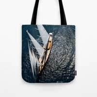 sailboat Tote Bags featuring sailboat by laika in cosmos