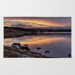 The Derwent Reservoir at sunset Rug