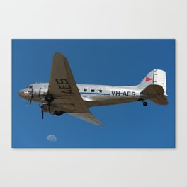 A DC-3 and the moon Canvas Print