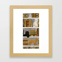 cat bookshelf Framed Art Print