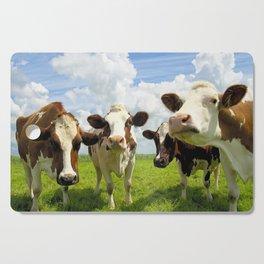 Four chatting cows Cutting Board