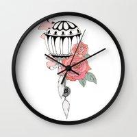 hot air balloon Wall Clocks featuring Hot Air Balloon Ride  by holmeg_art