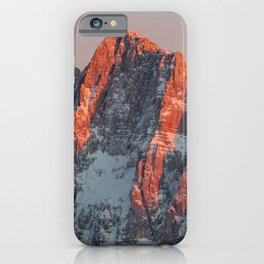 Sun light on snowy mountains iPhone Case