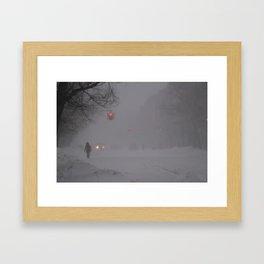 Woman walking on snow Framed Art Print
