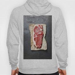 Raw beef steak on a dark slate background Hoody