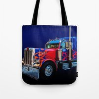 optimus prime Tote Bags featuring Optimus Prime Blue by Steve Purnell