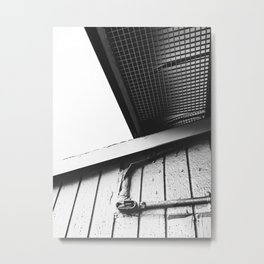 wood building in the city in black and white Metal Print