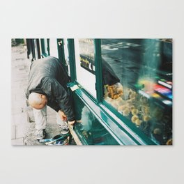 Man working on store front, quai Voltaire, Paris 2012 Canvas Print