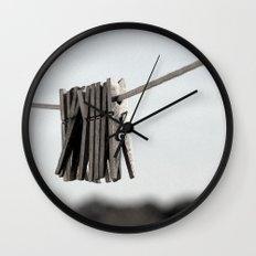 In a pinch Wall Clock