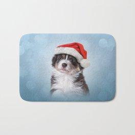Dog puppy Australian Shepherd in red hat of Santa Claus Bath Mat