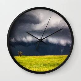 Passing By - Storm and Lone Tree in Nebraska Wall Clock