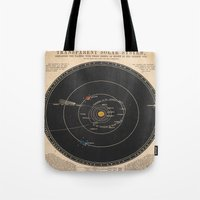 solar system Tote Bags featuring Solar System by Le petit Archiviste