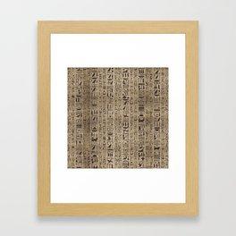 Egyptian hieroglyphs on wooden texture Framed Art Print