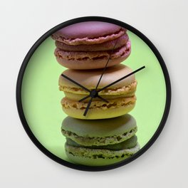 Macro shot of stack of macarons over green mint background, pastel toned Wall Clock