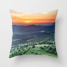Beautiful sunset behind green fields Throw Pillow