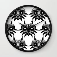 majoras mask Wall Clocks featuring Majoras Mask by Tom Milburn