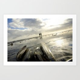 People walking at the beach in the winter light and winter sun Art Print