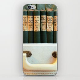 Aged Books in a Suitcase iPhone Skin