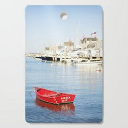 Vibrant Red Boat in Nantucket Harbor Cutting Board