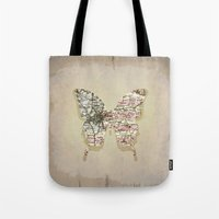 dallas Tote Bags featuring dallas butterfly by Steffi Louis