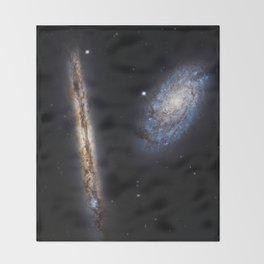 Galaxies NGC 4302 and NGC 4298 Throw Blanket