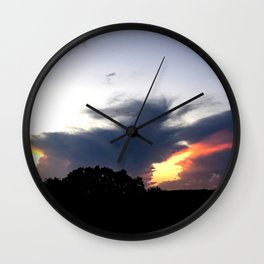 The Storm Clouds Retreat Wall Clock