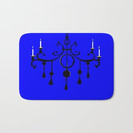 A Chandler with Candles and a Blue Background Bath Mat