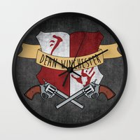 dean winchester Wall Clocks featuring Dean Winchester Crest by Andi Robinson