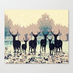 Deer in the snowy forest Canvas Print