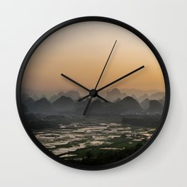 Sunset over Chinese fields Wall Clock
