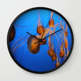 Floating In Blue Water Wall Clock