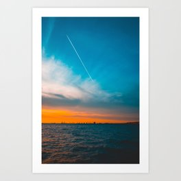 Beautiful sea in the afternoon with contrails in the sky Art Print