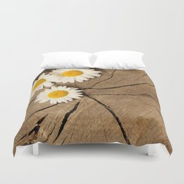 Daisies on wooden background Duvet Cover