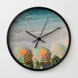 Umbrellas on the beach Wall Clock