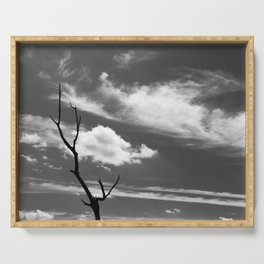 Black and white dead tree and sky with wispy clouds Serving Tray