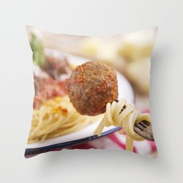 Spaghetti and meatball on a fork, plate in the background Throw Pillow
