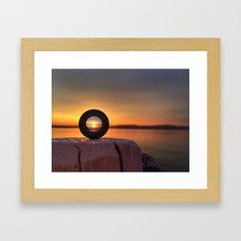 Sunset in a lens Framed Art Print